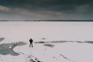 Thoughtful frustrated man on thin ice