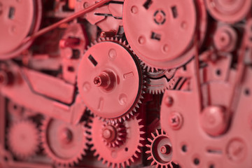Red gears and cogs macro shot, industrial background