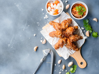 Deep fried chicken wing with garlic sauce in Korean style serve with kimchi and pickled radish on...