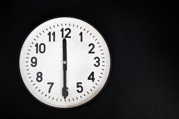 wall clock ion black background . place for text.