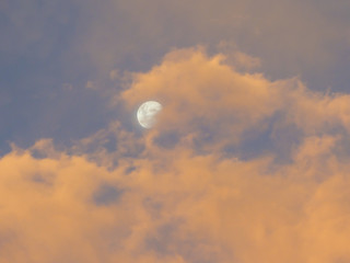 Cloudy pink sunset the moon in Uruguaiana, Brazil
