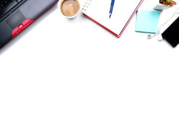 Top view or Flat lay style with copy space of workspace with laptop , pen , notebook , cup of coffee , sticky note and mobile phone and earphone on white table background or isolated