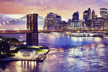 Brooklyn Bridge and the Manhattan at night, color toned picture, New York City, USA.