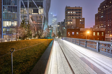 The Highline in Chelsea at night on a rainy day in winter. Manhattan, New York City