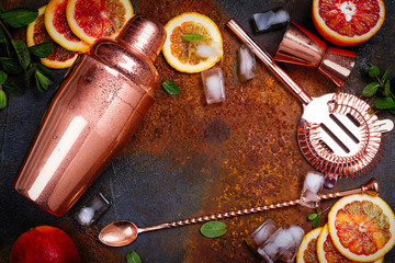 Bar accessories, drink tools and cocktail ingredients on rusty stone table. Flat lay style