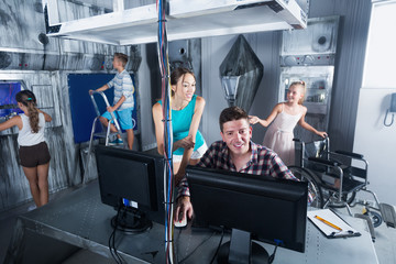 Family using PC in room stylized under laboratory
