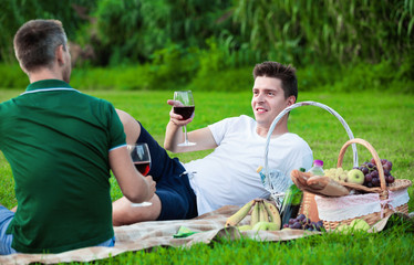 Man enjoying life on picnic outdoors with his friend