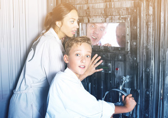 Mother with childred are helping dad and girl get out of the locked door