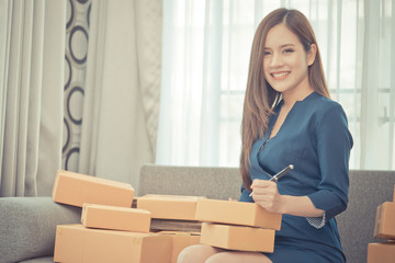 Business woman is checking stock in her online home business