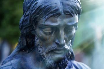 Fototapete - Statue of sad Jesus Christ (religion, faith, death, resurrection, eternity concept)