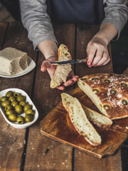 ciabatta - bread with olives on a wooden surface