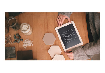 Tablet User with Interior Design Materials Mockup 1