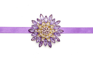 round brooch flower isolated on silk ribbon