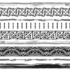 Set of seamless ethnic brushes and borders in black and white. African tribal design. Vector illustration.