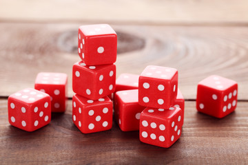 Red dice on brown wooden table