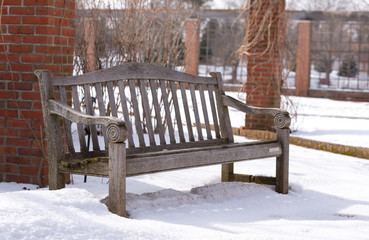 Old grey wooden bench in a park