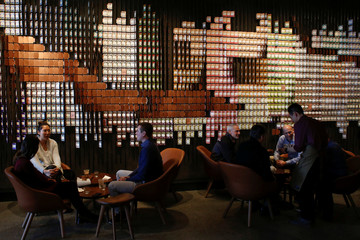 Customers chat over drinks as Starbucks Corp opens the first upscale Starbucks Reserve store at the Starbucks headquarters in Seattle