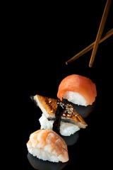 Set of sushi rolls of fresh fish salmon trout  shrimp eel with chopsticks