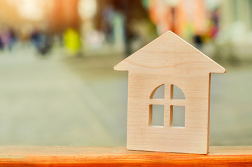 miniature wooden house. concept of real estate. sale of apartments. purchase of housing. apartments for rent. place for text. New house concept