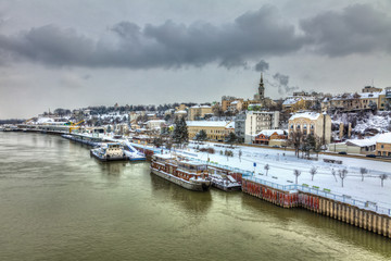A concrete ship in the Belgrade harbor and a snow covered city. HDR images