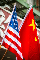 Chinese and American flags together outside