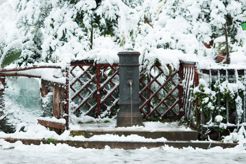 Roman fountain in the Centocelle district surrounded by snow