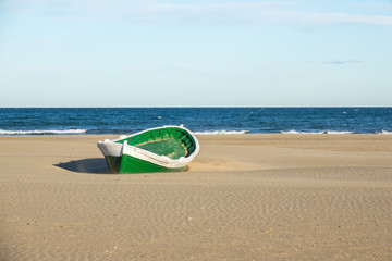 Malvarrosa Valencia Spain, Malvarrosa Valencia Spain wrecked wooden boat. boat stranded in the sand of a beach Broken abandoned boat in sand, sea coast line