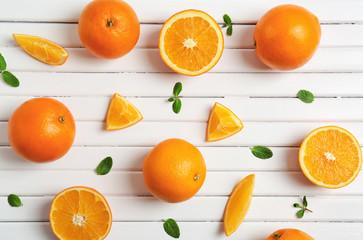 Juicy ripe oranges on light background