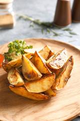 Tasty potato wedges on plate