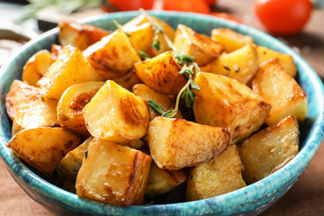 Bowl with tasty potato wedges, closeup