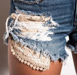 Close up Front View of a Woman in Distressed Denim Shorts