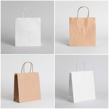 Set of blank shopping bags on light background. Mockup for design