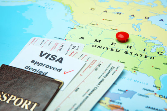 Passport, tickets and approved visa on map