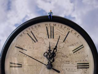 Man Sitting On Top Of Clock