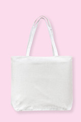 Tote bag canvas white cotton fabric cloth for eco shoulder shopping sack mockup blank template isolated on pastel pink background (clipping path)
