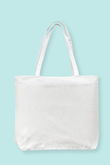 Tote bag canvas white cotton fabric cloth for eco shoulder shopping sack mockup blank template isolated on pastel blue background (clipping path)