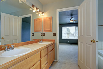 Master Bathroom suite features light wood vanity cabinet
