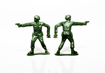 Two plastic green soldiers