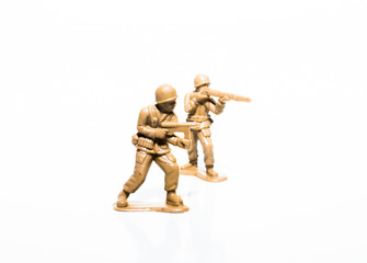 Two plastic tan soldiers