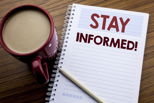 Hand writing text caption inspiration showing Stay Informed. Business concept for Be Awareness Or Awake written on note paper notepad book on the wooden background with coffee and pen.