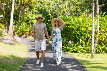 Couple walking on vacation in tropical resort