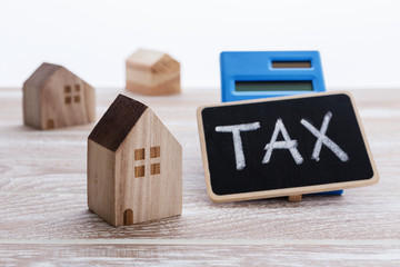Houses with tax sign for property tax concept