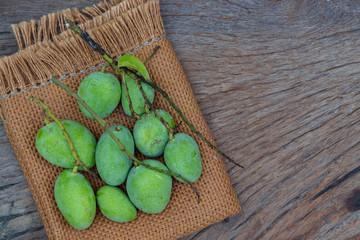 green mango on gunny sack texture