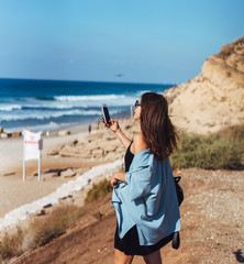 Young woman take a photo on smartphone