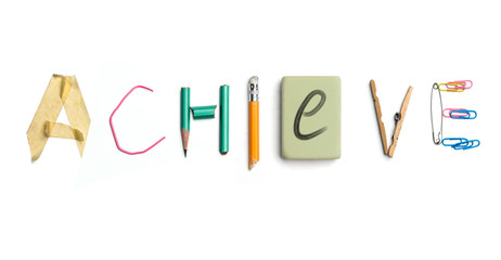 The word achieve created from office stationery.