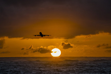 Aircraft flying over amazing tropical ocean at sunrise. Dominican Republic travel destinations.