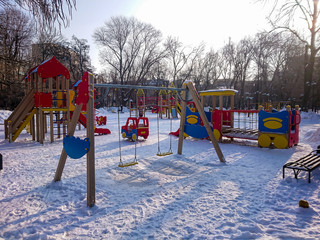 Children's Playground in the city Park. Sunny winter's day.