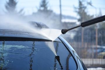 High-pressure washing car outdoors
