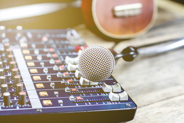Microphones with audio mixer, sound recorder and old instrument.