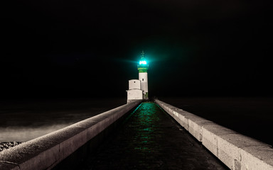 green light house in a dark night